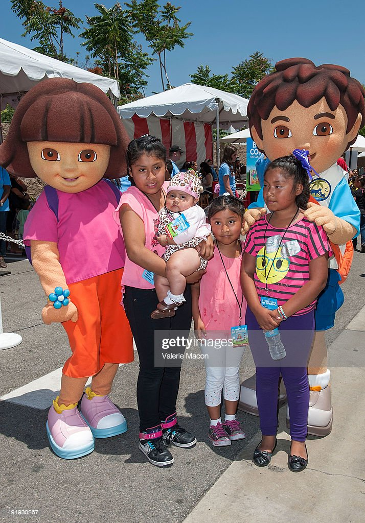 Dora The Explorer and her cousin Diego Marquez attend Universal Studios Hollywood 23rd Annual 'Christmas In Spring' Charity Event at M.E.N.D Transitional Living Center on May 31, 2014 in Pacoima, California.