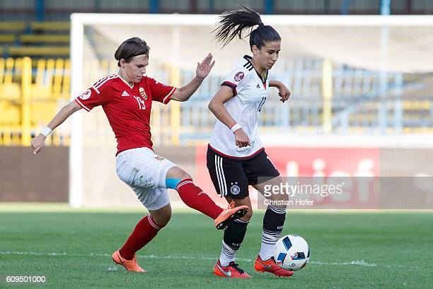 Dora Zeller of Hungary competes for the ball with Hasret Kayikci of Germany during the UEFA Women's Euro 2017 Qualifier between Hungary and Germany...