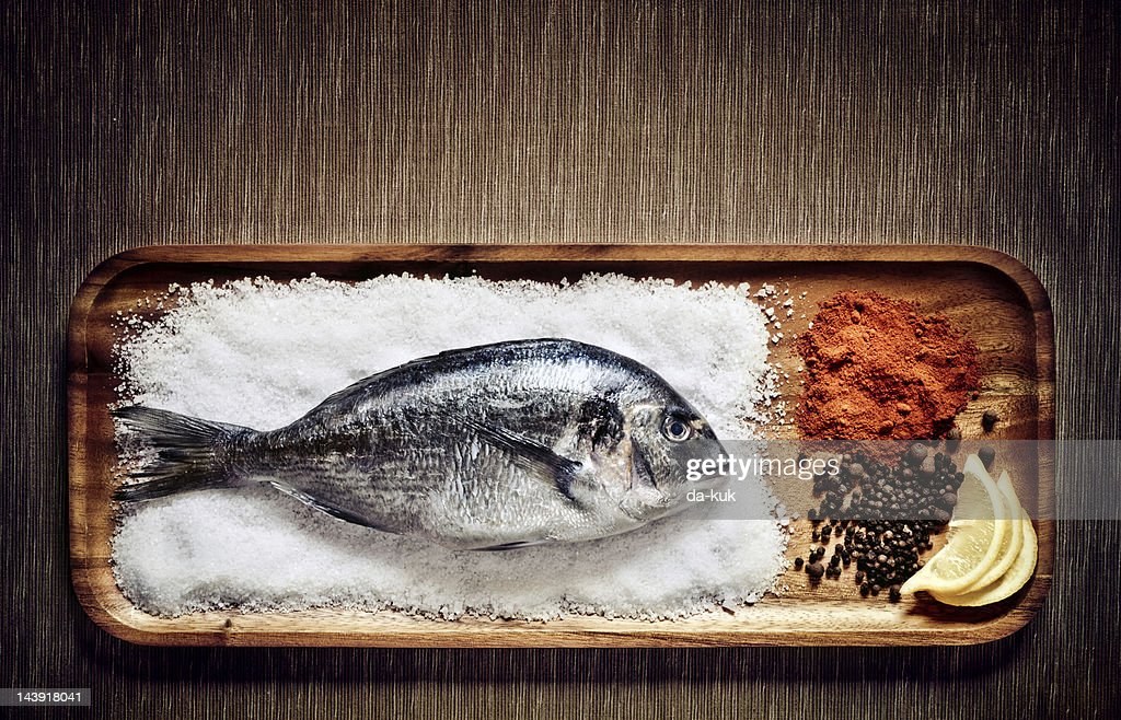 Dorado with spices : Stock Photo