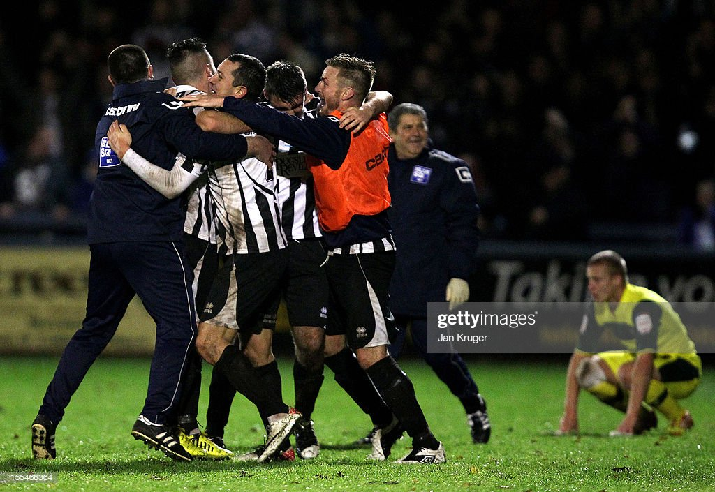 Dorchester Town players celebrate the win during the FA Cup with Budweiser 1st Round match between Dorchester Town and Plymouth Argyle at The Avenue Stadium on November 4, 2012 in Dorchester, England.
