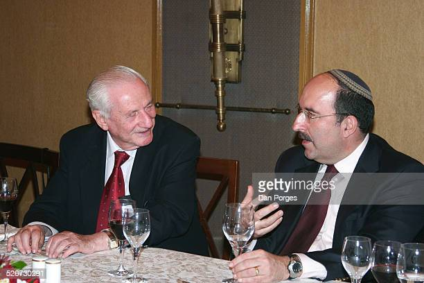 Dore Gold former Israeli ambassador to the UN and head of JPCA talking to former Supreme Court Justice Gabriel Bach at a conference on Israeli...
