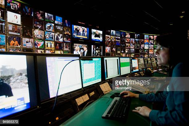 Doreen Daniello monitors television networks at the Time Warner Cable Inc master control room in New York US on Friday March 27 2009 Time Warner Inc...