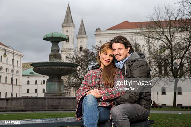 Doreen Dietel and her partner Tobias Guttenberg pose during a portrait session announcing her pregnancy infront of the fountain at...
