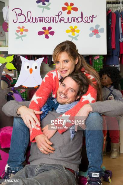 Doreen Dietel and her partner Tobias Guttenberg pose during a portrait session announcing her pregnancy at the baby clothing store 'Blumenkinder' on...