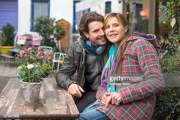 Doreen Dietel and her partner Tobias Guttenberg pose during a portrait session announcing her pregnancy at cafe Gartensalon on November 9 2013 in...