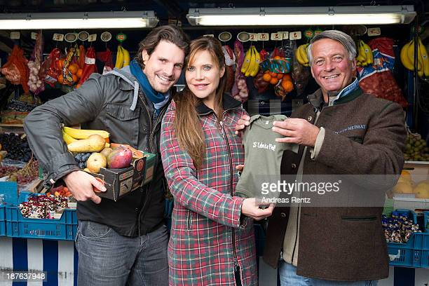 Doreen Dietel her partner Tobias Guttenberg and Didi pose during a portrait session announcing her pregnancy at Didi's fruit stand on November 9 2013...