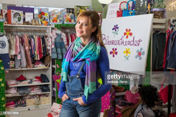 Doreen Dietel poses during a portrait session announcing her pregnancy at the baby clothing store 'Blumenkinder' on November 9 2013 in Munich Germany