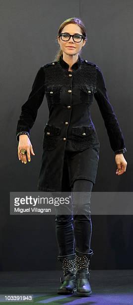 Doreen Dietel walks on the fashion runway during the fashion show of the Christine Neubauer Limited Edition By Schiffhauer Munich on August 15 2010...