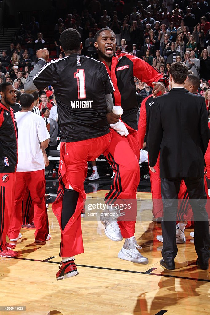 <a gi-track='captionPersonalityLinkClicked' href=/galleries/search?phrase=Dorell+Wright&family=editorial&specificpeople=211344 ng-click='$event.stopPropagation()'>Dorell Wright</a> #1 and <a gi-track='captionPersonalityLinkClicked' href=/galleries/search?phrase=Wesley+Matthews+-+Basketball+Player&family=editorial&specificpeople=804816 ng-click='$event.stopPropagation()'>Wesley Matthews</a> #2 of the Portland Trail Blazers run out before the game against the New Orleans Pelicans on December 21, 2013 at the Moda Center Arena in Portland, Oregon.