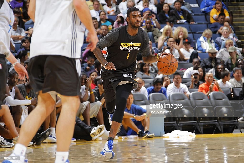 Dorell Wright #1 of the Golden State Warriors dribbles up the court at the team's annual Open Practice on October 6, 2010 in Oakland, California.