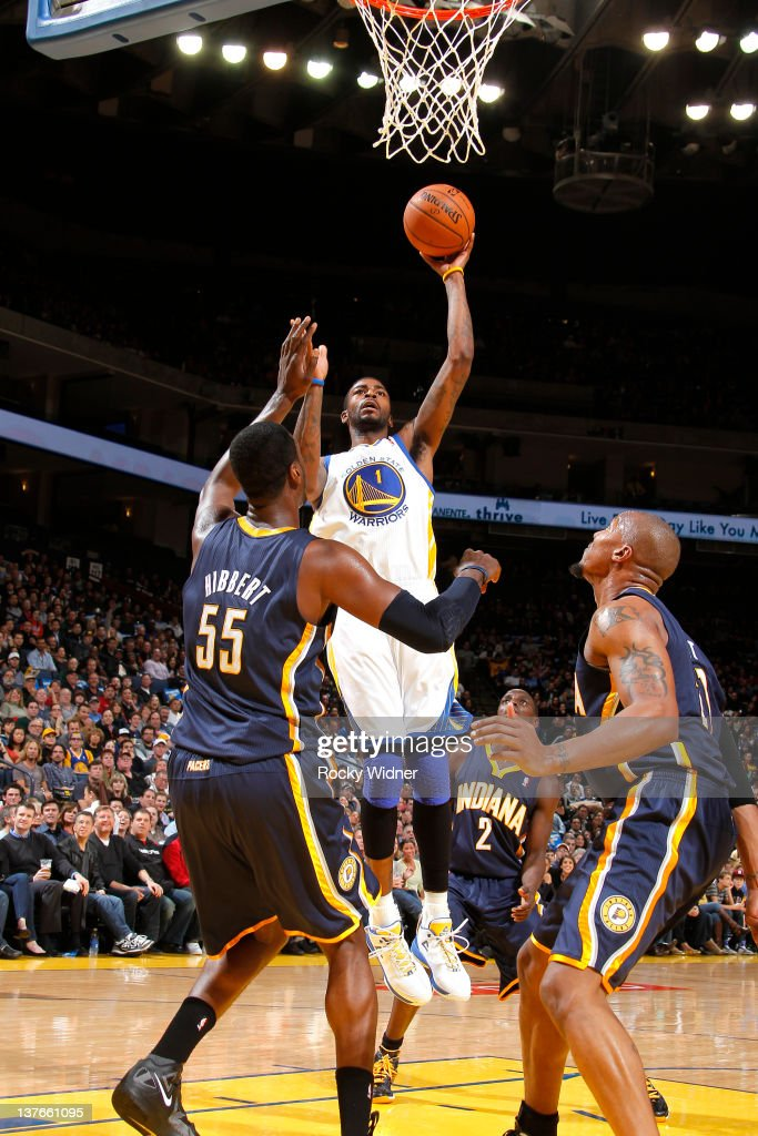 <a gi-track='captionPersonalityLinkClicked' href=/galleries/search?phrase=Dorell+Wright&family=editorial&specificpeople=211344 ng-click='$event.stopPropagation()'>Dorell Wright</a> #1 of the Golden State Warriors flips up a shot over <a gi-track='captionPersonalityLinkClicked' href=/galleries/search?phrase=Roy+Hibbert&family=editorial&specificpeople=725128 ng-click='$event.stopPropagation()'>Roy Hibbert</a> #55 and David West #21 of the Indiana Pacers on January 20, 2012 at Oracle Arena in Oakland, California.
