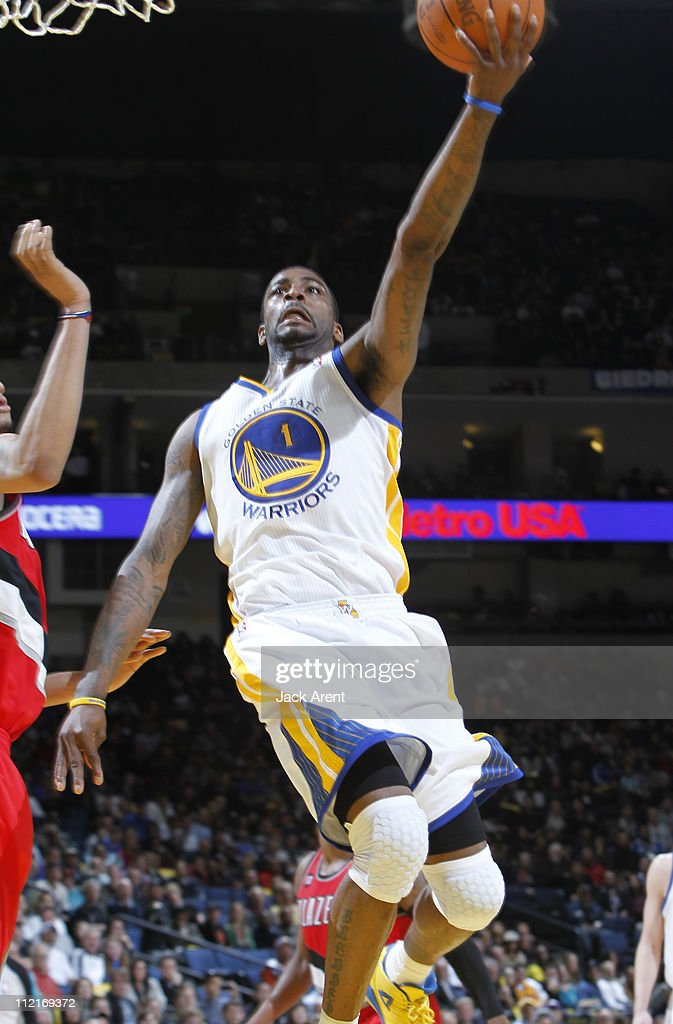 Dorell Wright #1 of the Golden State Warriors scores on the layup against the Portland Trail Blazers on April 13, 2011 at Oracle Arena in Oakland, California.