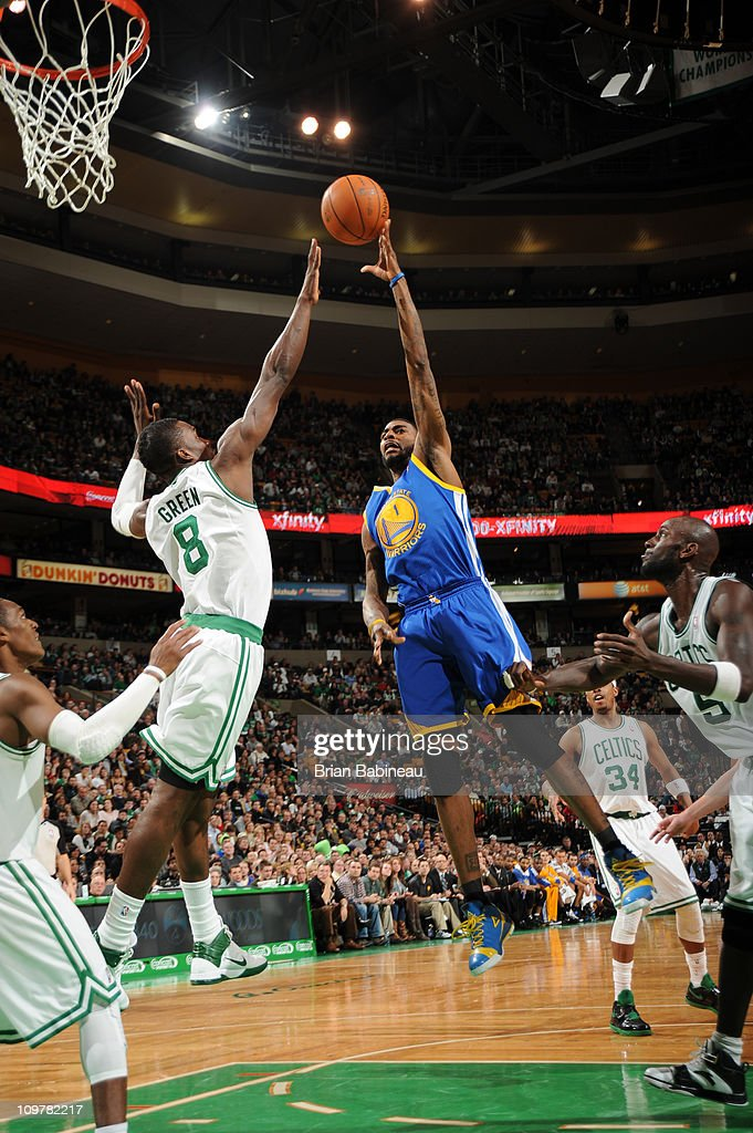 <a gi-track='captionPersonalityLinkClicked' href=/galleries/search?phrase=Dorell+Wright&family=editorial&specificpeople=211344 ng-click='$event.stopPropagation()'>Dorell Wright</a> #1 of the Golden State Warriors shoots against Jeff Green #8 of the Boston Celtics on March 4, 2011 at the TD Garden in Boston, Massachusetts.