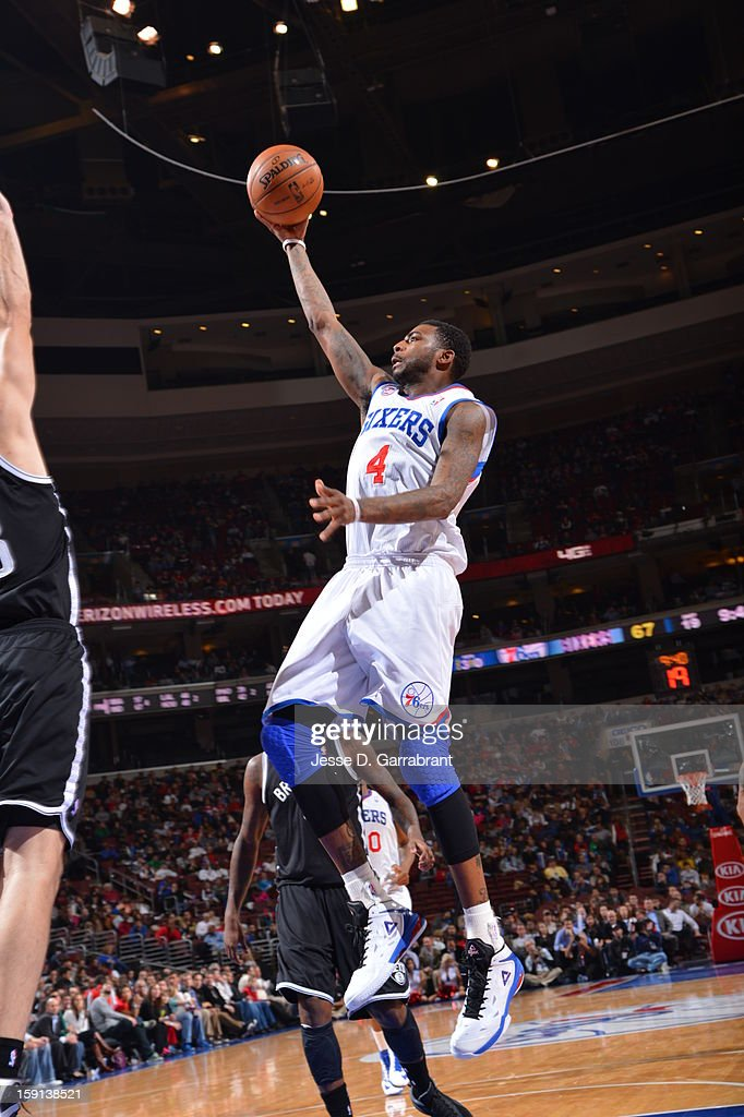 <a gi-track='captionPersonalityLinkClicked' href=/galleries/search?phrase=Dorell+Wright&family=editorial&specificpeople=211344 ng-click='$event.stopPropagation()'>Dorell Wright</a> #4 of the Philadelphia 76ers attempts a layup against the Brooklyn Nets during the game at the Wells Fargo Center on January 8, 2013 in Philadelphia, Pennsylvania.