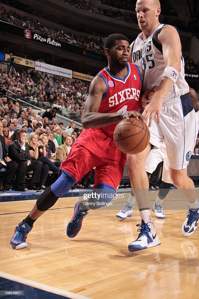 <a gi-track='captionPersonalityLinkClicked' href=/galleries/search?phrase=Dorell+Wright&family=editorial&specificpeople=211344 ng-click='$event.stopPropagation()'>Dorell Wright</a> #4 of the Philadelphia 76ers drives against <a gi-track='captionPersonalityLinkClicked' href=/galleries/search?phrase=Chris+Kaman&family=editorial&specificpeople=201661 ng-click='$event.stopPropagation()'>Chris Kaman</a> #35 of the Dallas Mavericks on December 18, 2012 at the American Airlines Center in Dallas, Texas.