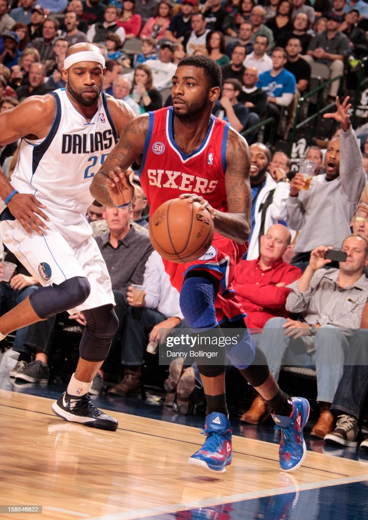 <a gi-track='captionPersonalityLinkClicked' href=/galleries/search?phrase=Dorell+Wright&family=editorial&specificpeople=211344 ng-click='$event.stopPropagation()'>Dorell Wright</a> #4 of the Philadelphia 76ers drives against <a gi-track='captionPersonalityLinkClicked' href=/galleries/search?phrase=Vince+Carter&family=editorial&specificpeople=201488 ng-click='$event.stopPropagation()'>Vince Carter</a> #25 of the Dallas Mavericks on December 18, 2012 at the American Airlines Center in Dallas, Texas.