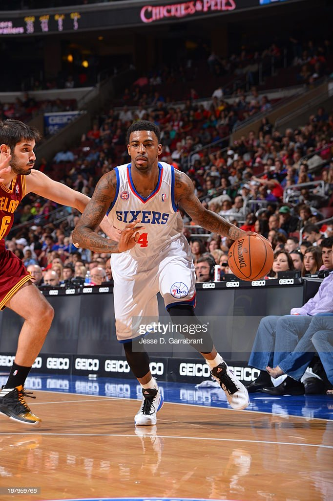 <a gi-track='captionPersonalityLinkClicked' href=/galleries/search?phrase=Dorell+Wright&family=editorial&specificpeople=211344 ng-click='$event.stopPropagation()'>Dorell Wright</a> #4 of the Philadelphia 76ers drives to the basket against the Cleveland Cavaliers at the Wells Fargo Center on April 14, 2013 in Philadelphia, Pennsylvania.