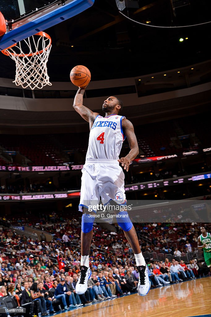 Dorell Wright #4 of the Philadelphia 76ers dunks against the Boston Celtics during a pre-season game at the Wells Fargo Center on October 15, 2012 in Philadelphia, Pennsylvania.