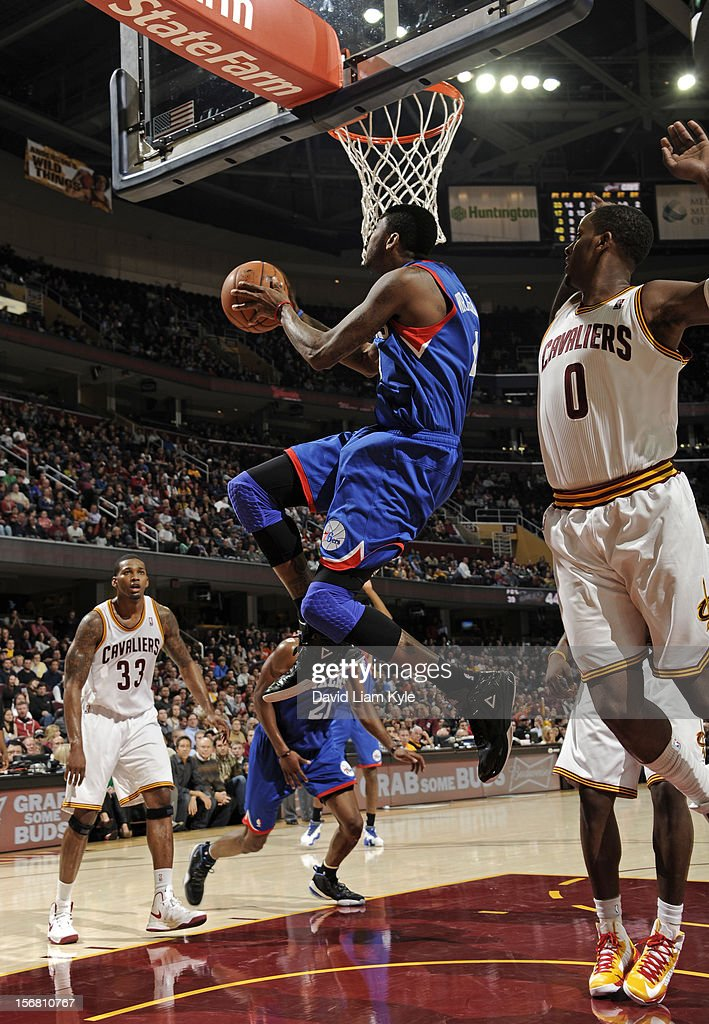 <a gi-track='captionPersonalityLinkClicked' href=/galleries/search?phrase=Dorell+Wright&family=editorial&specificpeople=211344 ng-click='$event.stopPropagation()'>Dorell Wright</a> #4 of the Philadelphia 76ers goes up under the basket for the shot against <a gi-track='captionPersonalityLinkClicked' href=/galleries/search?phrase=C.J.+Miles&family=editorial&specificpeople=641491 ng-click='$event.stopPropagation()'>C.J. Miles</a> #0 of the Cleveland Cavaliers at The Quicken Loans Arena on November 21, 2012 in Cleveland, Ohio.