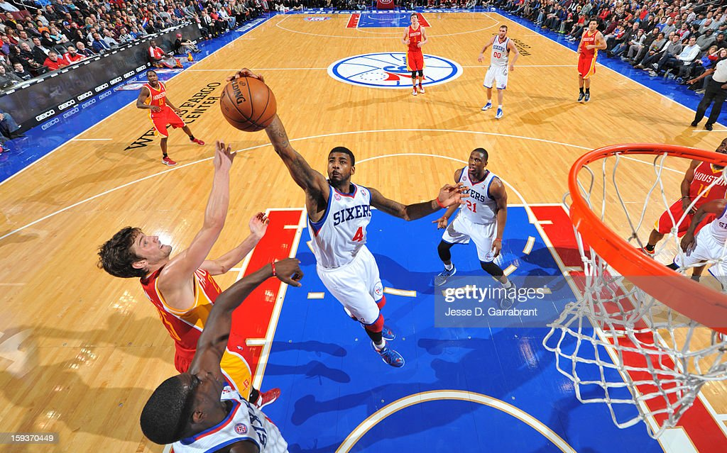 <a gi-track='captionPersonalityLinkClicked' href=/galleries/search?phrase=Dorell+Wright&family=editorial&specificpeople=211344 ng-click='$event.stopPropagation()'>Dorell Wright</a> #4 of the Philadelphia 76ers rebounds against <a gi-track='captionPersonalityLinkClicked' href=/galleries/search?phrase=Chandler+Parsons&family=editorial&specificpeople=4249869 ng-click='$event.stopPropagation()'>Chandler Parsons</a> #25 of the Houston Rockets during the game at the Wells Fargo Center on January 12, 2013 in Philadelphia, Pennsylvania.