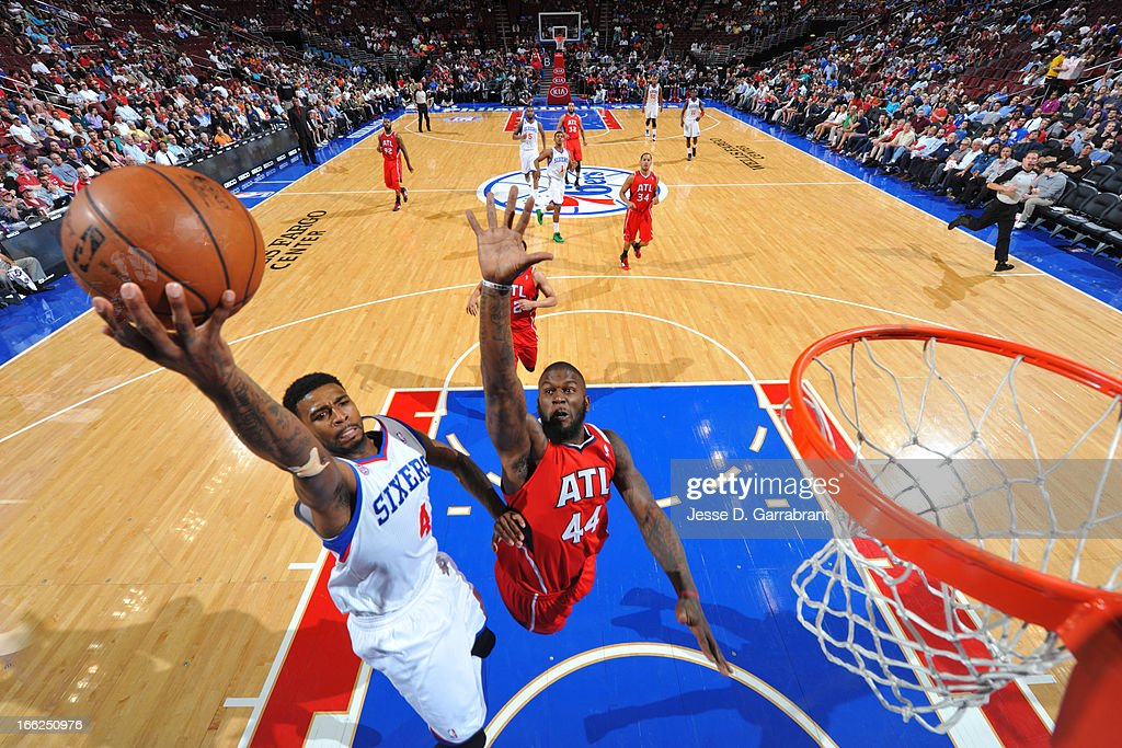 Dorell Wright #4 of the Philadelphia 76ers shoots a layup against Ivan Johnson #44 of the Atlanta Hawks at the Wells Fargo Center on April 10, 2013 in Philadelphia, Pennsylvania.