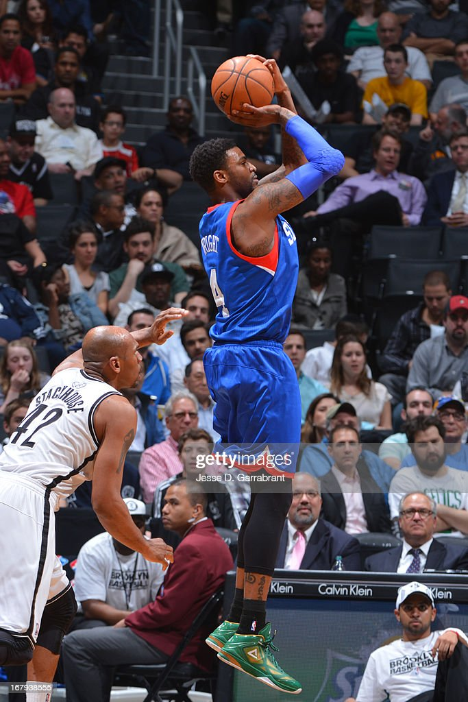 <a gi-track='captionPersonalityLinkClicked' href=/galleries/search?phrase=Dorell+Wright&family=editorial&specificpeople=211344 ng-click='$event.stopPropagation()'>Dorell Wright</a> #4 of the Philadelphia 76ers shoots against <a gi-track='captionPersonalityLinkClicked' href=/galleries/search?phrase=Jerry+Stackhouse&family=editorial&specificpeople=201683 ng-click='$event.stopPropagation()'>Jerry Stackhouse</a> #42 of the Brooklyn Nets on April 9, 2013 at the Barclays Center in Brooklyn, New York.