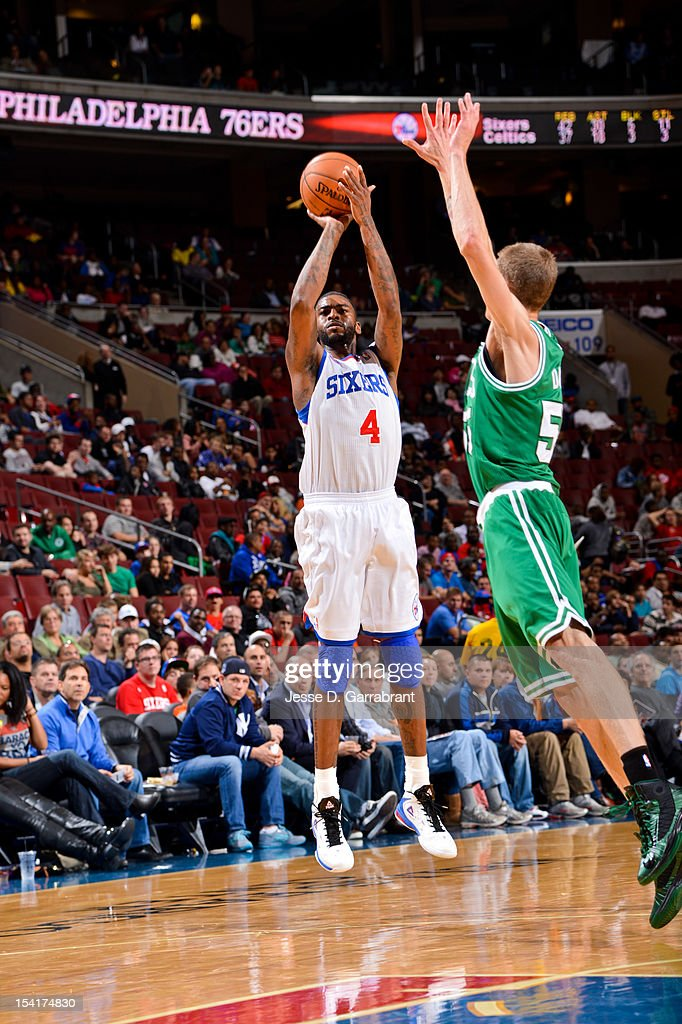 Dorell Wright #4 of the Philadelphia 76ers shoots against Micah Downs #55 of the Boston Celtics during a pre-season game at the Wells Fargo Center on October 15, 2012 in Philadelphia, Pennsylvania.