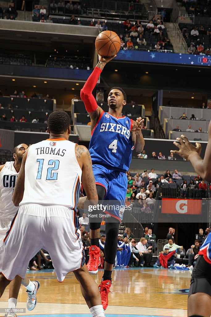 <a gi-track='captionPersonalityLinkClicked' href=/galleries/search?phrase=Dorell+Wright&family=editorial&specificpeople=211344 ng-click='$event.stopPropagation()'>Dorell Wright</a> #4 of the Philadelphia 76ers shoots against <a gi-track='captionPersonalityLinkClicked' href=/galleries/search?phrase=Tyrus+Thomas&family=editorial&specificpeople=453285 ng-click='$event.stopPropagation()'>Tyrus Thomas</a> #12 of the Charlotte Bobcats at the Time Warner Cable Arena on April 3, 2013 in Charlotte, North Carolina.