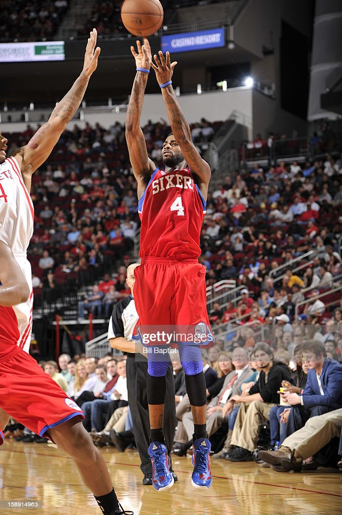 <a gi-track='captionPersonalityLinkClicked' href=/galleries/search?phrase=Dorell+Wright&family=editorial&specificpeople=211344 ng-click='$event.stopPropagation()'>Dorell Wright</a> #4 of the Philadelphia 76ers takes a shot against the Houston Rockets on December 19, 2012 at the Toyota Center in Houston, Texas.