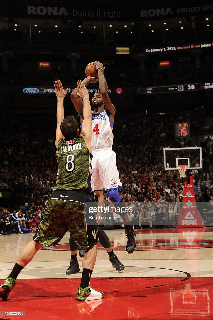 <a gi-track='captionPersonalityLinkClicked' href=/galleries/search?phrase=Dorell+Wright&family=editorial&specificpeople=211344 ng-click='$event.stopPropagation()'>Dorell Wright</a> #4 of the Philadelphia 76ers takes a shot over <a gi-track='captionPersonalityLinkClicked' href=/galleries/search?phrase=Jose+Calderon&family=editorial&specificpeople=548297 ng-click='$event.stopPropagation()'>Jose Calderon</a> #8 of the Toronto Raptors during the game on November 10, 2012 at the Air Canada Centre in Toronto, Ontario, Canada.