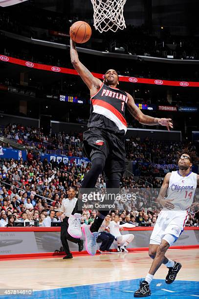 Dorell Wright of the Portland Trail Blazers goes for a dunk against Chris DouglasRoberts of the Los Angeles Clippers during the game on October 24...