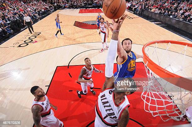 Dorell Wright of the Portland Trail Blazers jumps for a rebound against Andrew Bogut of the Golden State Warriors on March 24 2015 at the Moda Center...
