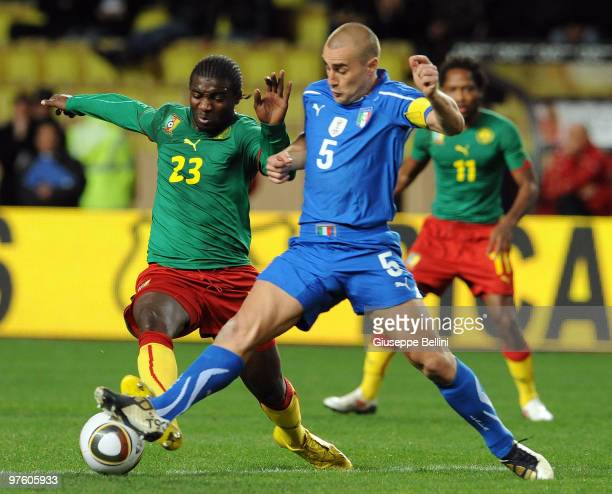 Dorge Kouemaha of Cameroon and Fabio Cannavaro of Italy in action during the International Friendly match between Italy and Cameroon at Louis II...