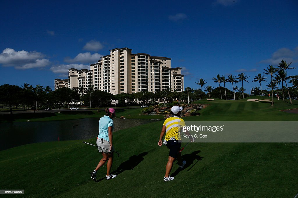 Dori Carter and Jane Rah walk up the eighth hole during the second round of the LPGA LOTTE Championship Presented by J Golf at the Ko Olina Golf Club on April 18, 2013 in Kapolei, Hawaii.