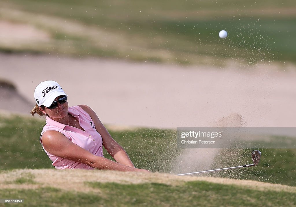 Dori Carter chips from the bunker onto the 15th hole green during the second round of the RR Donnelley LPGA Founders Cup at Wildfire Golf Club on March 15, 2013 in Phoenix, Arizona.