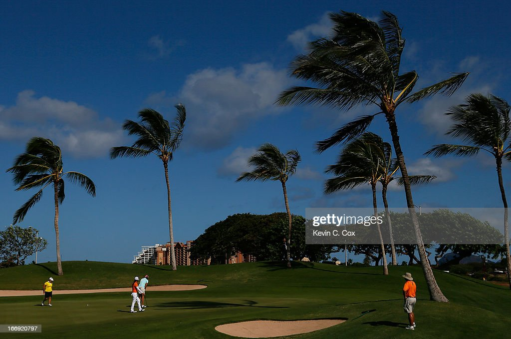 Dori Carter, Jane Rah and Thidapa Suwannapura of Thailand walk on the seventh green during the second round of the LPGA LOTTE Championship Presented by J Golf at the Ko Olina Golf Club on April 18, 2013 in Kapolei, Hawaii.