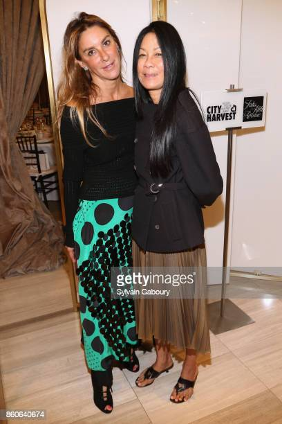 Dori Cooperman and Helen Lee Schifter attend Saks Fifth Avenue Luncheon to Benefit City Harvest at Saks Fifth Avenue on October 12 2017 in New York...