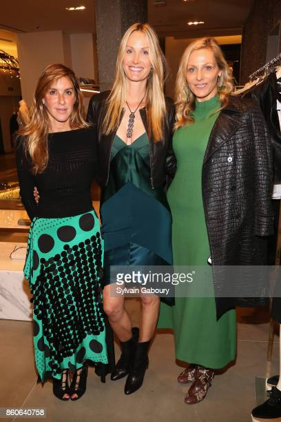Dori Cooperman Christine Mack and Jamie Tisch attend Saks Fifth Avenue Luncheon to Benefit City Harvest at Saks Fifth Avenue on October 12 2017 in...