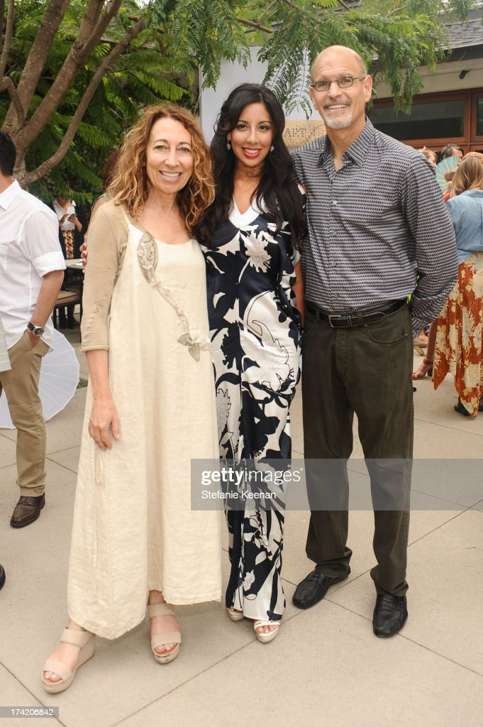 Dori Peterman Mostov, Veronica Fernandez and Charles Mostov attend LAXART 2013 Garden Party on July 21, 2013 in Los Angeles, California.