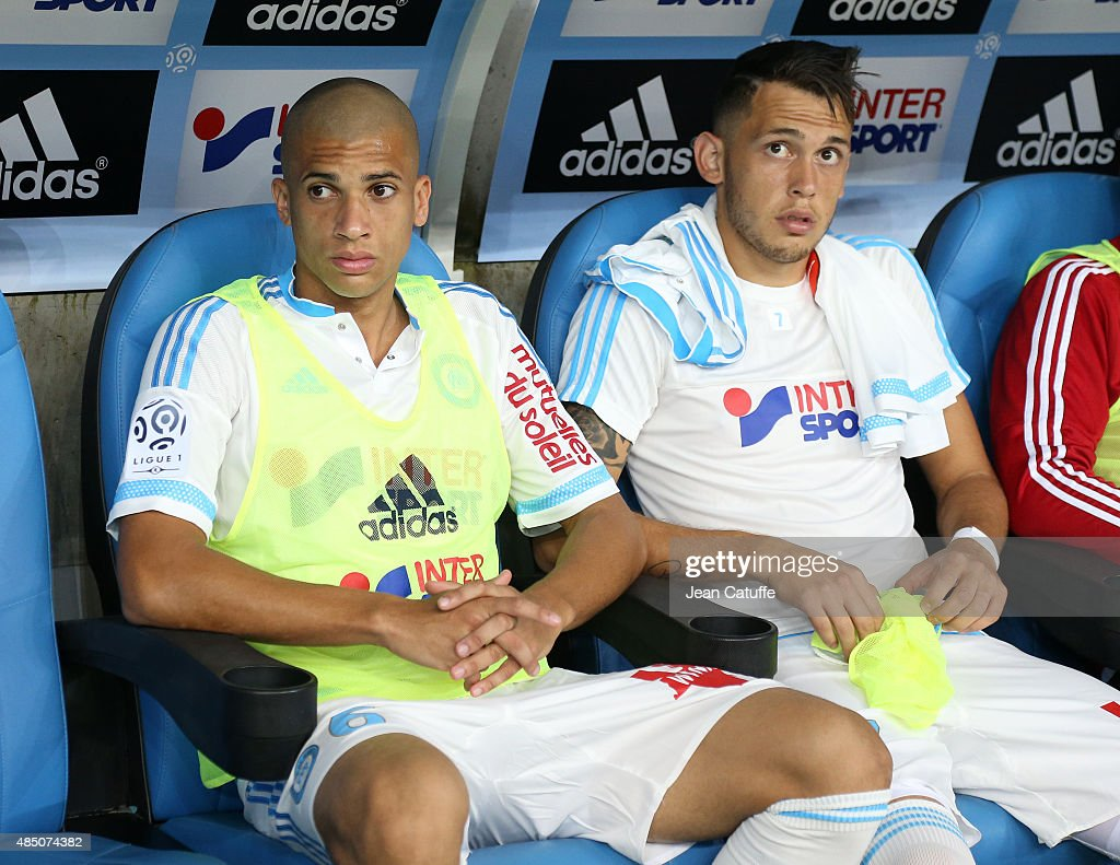 Doria and Lucas Ocampos of OM seat on the bench during the French Ligue 1 match between Olympique de Marseille (OM) and Troyes ESTAC at New Stade Velodrome on August 23, 2015 in Marseille, France.
