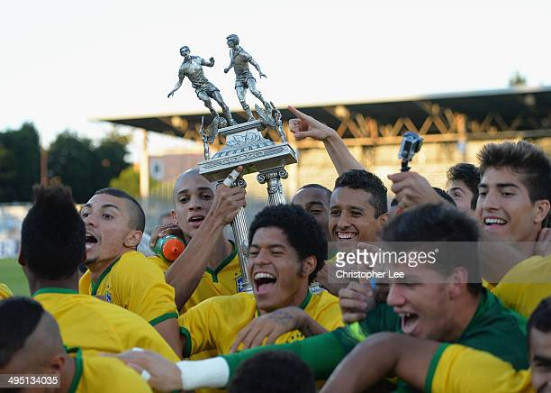 Doria and Marquinhos of Brazil lift the trophy as the rest of Brazil start to celebrate their victory during the Final of the Toulon Tournament...