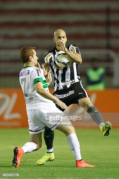 Doria of Botafogo strugles for the ball with Ze Love of Coritiba during the match between Botafogo and Coritiba for the Brazilian Series A 2014 at...