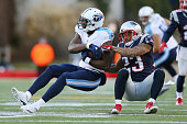 Dorial GreenBeckham of the Tennessee Titans is tackled by Patrick Chung of the New England Patriots during the second half of their game at Gillette...