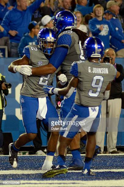 Dorian Baker of the Kentucky Wildcats is congratulated by teammates Ramsey Meyers of the Kentucky Wildcats and Garrett Johnson of the Kentucky...