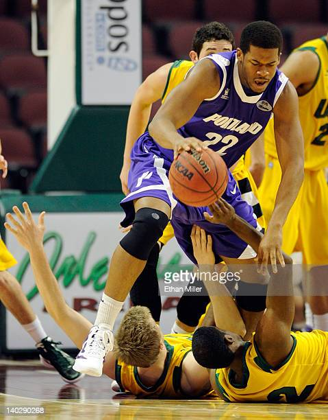 Dorian Cason of the Portland Pilots dribbles over Gavin Hoffmann and Avery Johnson of the San Francisco Dons during the second round of the Zapposcom...