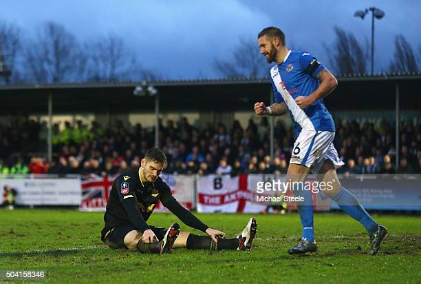 Dorian Dervite of Bolton Wanderers shows his dejection after conceding the own goal while Paul Reid of Eastleigh celebrates during the Emirates FA...