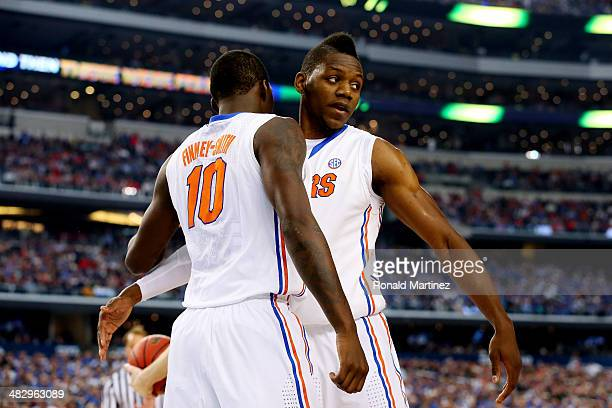 Dorian FinneySmith and Will Yeguete of the Florida Gators celebrate against the Connecticut Huskies during the NCAA Men's Final Four Semifinal at ATT...