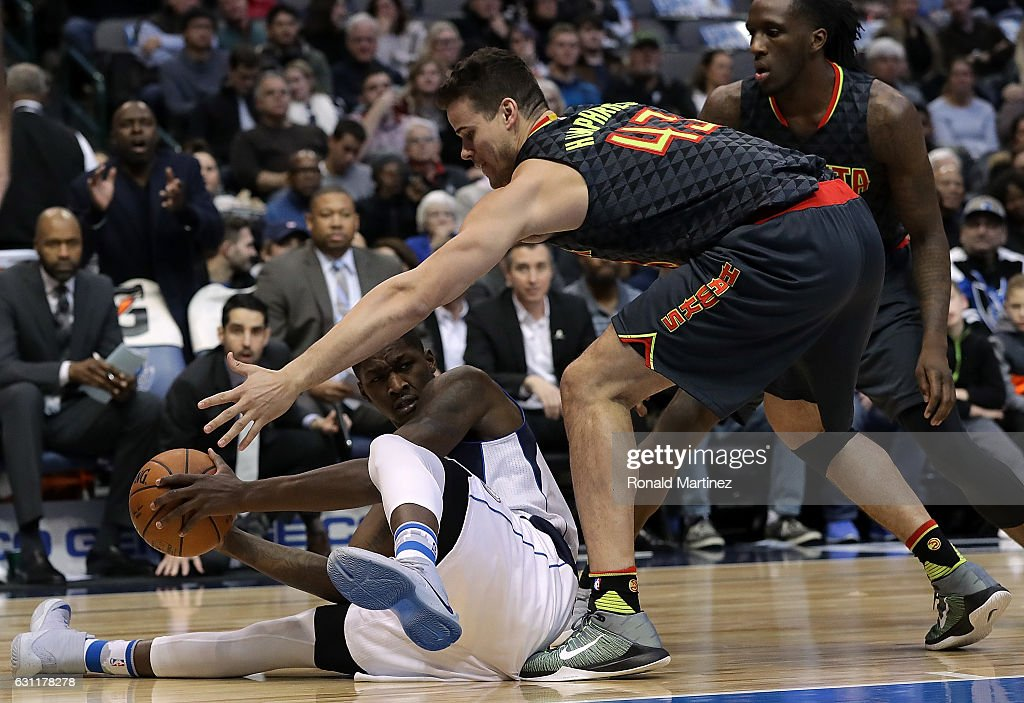 Dorian Finney-Smith #10 of the Dallas Mavericks makes a pass attempt while defended by Kris Humphries #43 of the Atlanta Hawks at American Airlines Center on January 7, 2017 in Dallas, Texas.