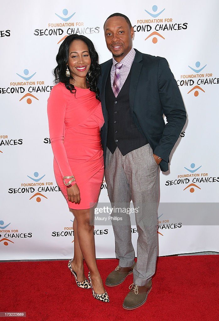 <a gi-track='captionPersonalityLinkClicked' href=/galleries/search?phrase=Dorian+Missick&family=editorial&specificpeople=678688 ng-click='$event.stopPropagation()'>Dorian Missick</a> (R) and Simone Missick arrive at Foundation For Second Chances 'Harlem Nights' Casino event at Huntley Hotel on July 9, 2013 in Santa Monica, California.