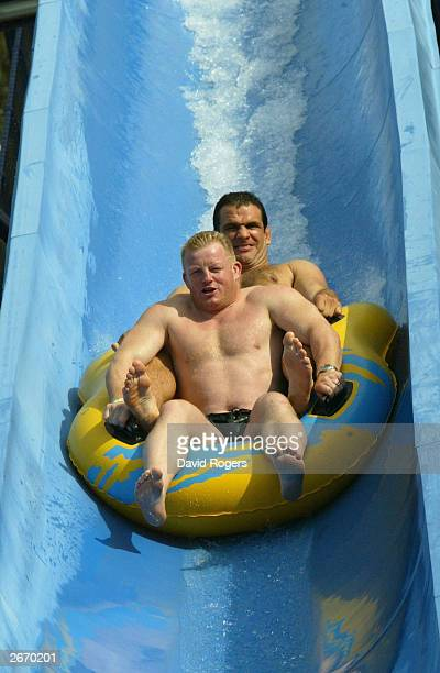 Dorian West and Martin Johnson of England enjoy the waterslide at the Wet 'n' Wild theme park October 28 2003 the Gold Coast Australia